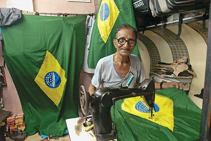 In step A Brazil flag being tailored at a Calcutta market