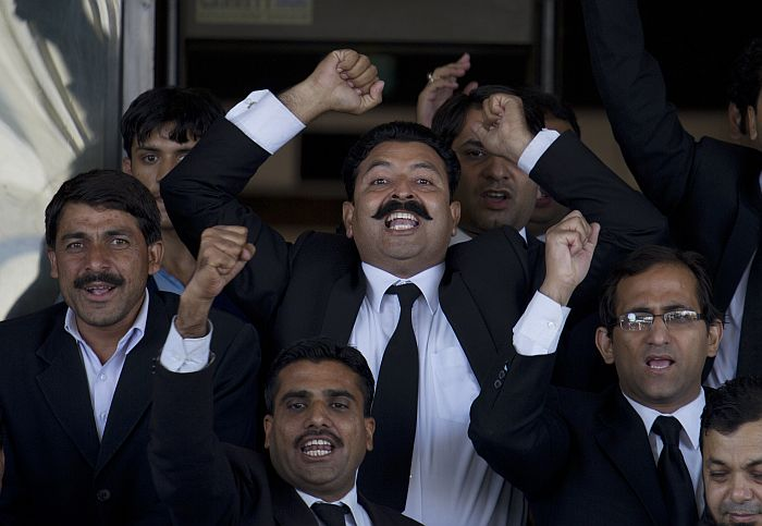 Pakistani lawyers chant slogans in favor of the Supreme Court's decision against Pakistan's Prime Minister, Yousuf Reza Gilani, not pictured, outside the court in Islamabad, Pakistan. Pakistan's top court ruled on June 19 that Gilani was no longer eligible to hold office due to an earlier contempt conviction, ushering in fresh political turmoil in the nuclear-armed country. - AP Photo/B.K. Bangash