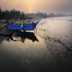 Indian fishermen push their boat ashore at sunrise after a night of fishing at Morjim beach in north Goa, on the Arabian Sea, Southern India.